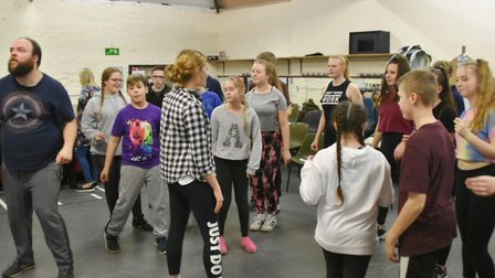 Members of Dereham youth theatre group DOSTYCo rehearsing for the rock and roll musical Return to th