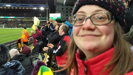 Ruth Cordle watching her beloved Norwich City. Ruth, 27, will now be able to attend events with a n