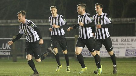 Dereham players celebrate as another goal goes in during their impressive recent run - but it has be