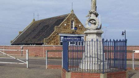 The Eliza Adams memorial, with the Wells harbour office in the background, which was the lifeboat st
