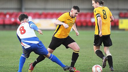 Action from Fakenham Town's Thurlow Nunn Premier Division win over FC Clacton last weekend. They fol