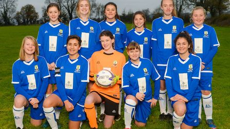 The under-14s girls Wells football team, pictured on Saturday, November 18, in their new kit sponsor