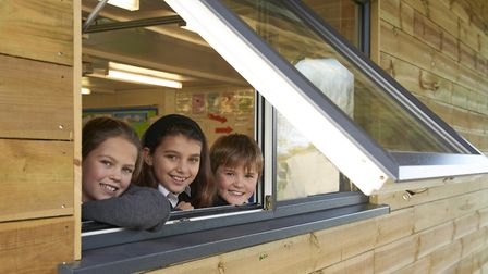 Langham schoolchildren enjoy the view from their new outdoor learning centre. Pictures: Heather Wood