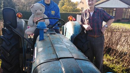 Dereham Cats Protection senior care assistant Samantha Wright withTony Hood and his vintage Fordson