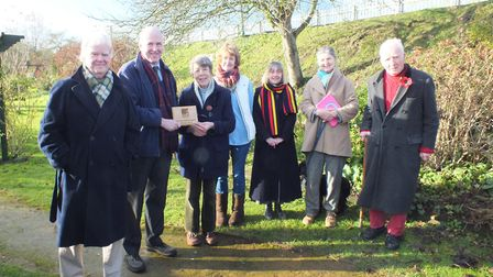 Tom FitzPatrick presenting the plaque to Sylvia Batchelor of St Seraphim''s Trust.Pictures: NNDC