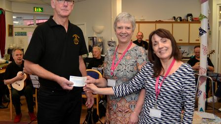 Fakenham Ukulele Group handed a cheque to the Community Hub. Picture: Peter Bird