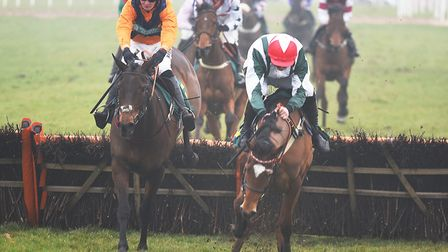 Potters Midnight (Jack Quinlan) and (R) All My Love (Kielan Woods) battling out in the Fakenham Silv
