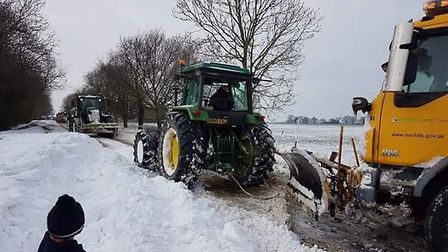 A snow plough was pulled free by a tractor in Ashill. Picture: Becky Watts