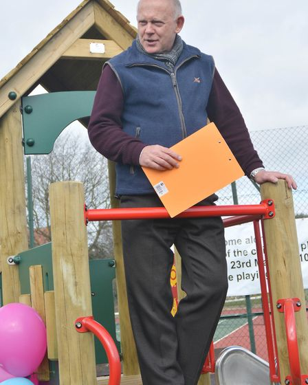 Former Burnham Market Parish Council chairman Geof Hanley welcomes visitors to the official opening