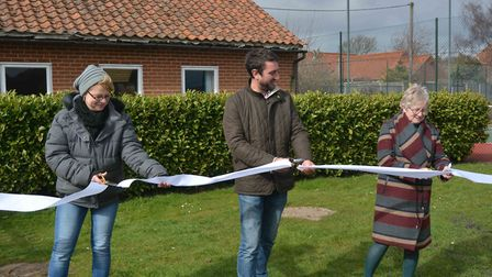 Parish council play area sub committee members Jayne Marshall, Jez Scoles and Cindy Stimpson cut a r