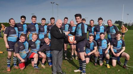 Fakenham being presented with the Eastern Counties Shield by Ian Forton, President of Eastern Counti