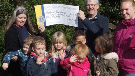 Swaffham and District Lions Club president John Collins presenting Marham Village Pre-school with a