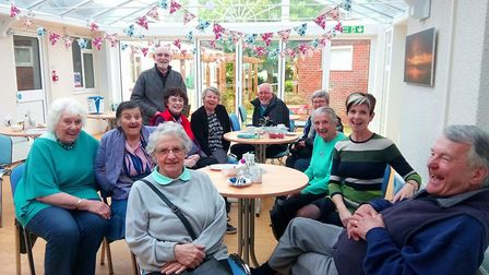 The Nurture Project participants having a cup of tea in the conservatory after gardening at Wells Ho