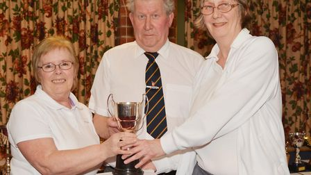 Ladies pairs winners, Pam Frary and Louise Hannant are presented with their trophy by lady's preside