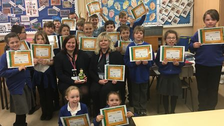 Charley (left of centre) and Michelle with the Swanton Morley pupils who took part in the Money Acad