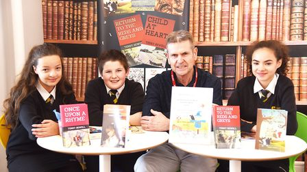 Author Terry Sewell with the winning Fakenham Academy students (from left) Freya Woodward, Dylan Eng