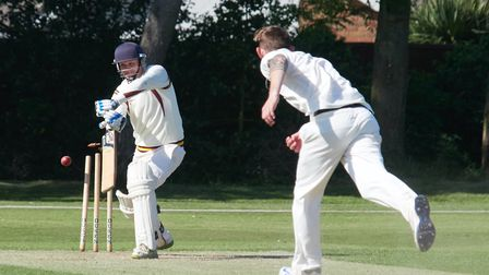 Fakenham''s Lloyd Marshall claims another Garboldisham wicket on a memorable afteroon at Highfield L
