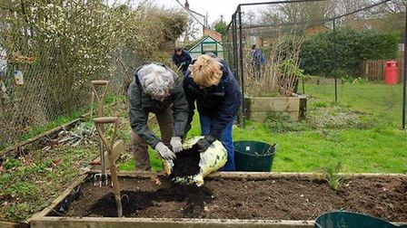 Volunteers helping with a spring makeover at North Elmham Primary School.Photo: submitted