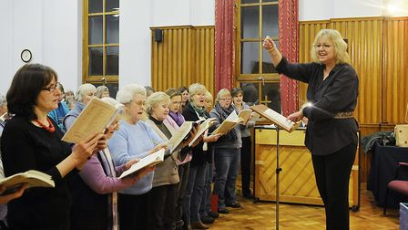 Musical director Janet Kelsey directing the Fakenham Choral Society at the Salvation Army Hall, Fake