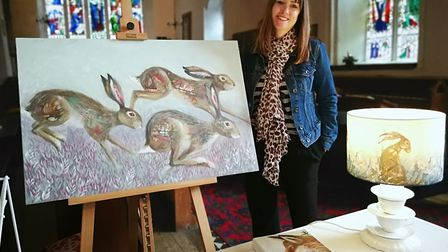 Docking's annual Hare Fair 2018. Artist Nicola Hart with her paintings. Picture: DONNA-LOUISE BISHOP