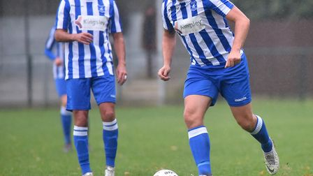 Former Norwich City footballers Simon Lappin and Grant Holt in action for Wroxham FC against Fakenha