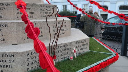 The Fakeham War Memorial decorated with handcrafted poppies to mark a century since the Armistice. P