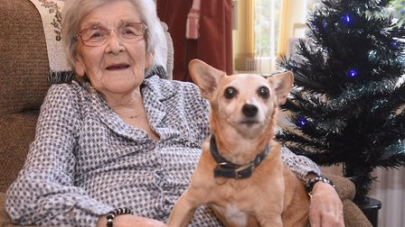 Marjorie Neve of Fakenham, celebrating her 100th birthday with Sally, known as Puppy. Picture: DENIS