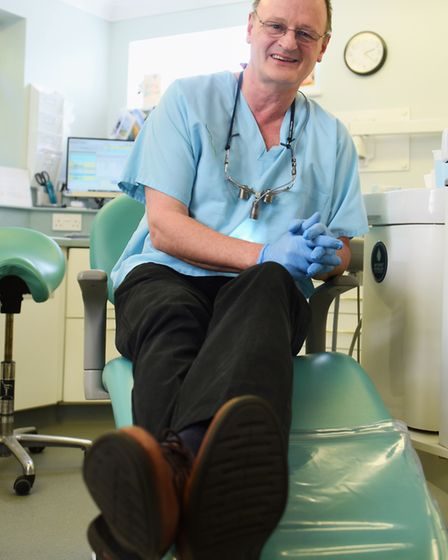 Mike Edgecombe ready to put his feet up as he retires from being a dentist at Dereham for 37 years.