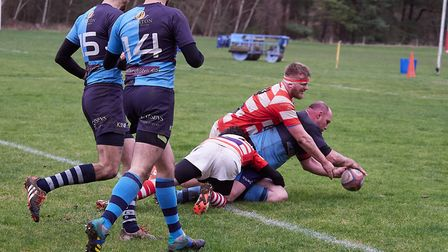 Fakenham man-of-the-match Rob Ward scores the second of his brace of tries in a dramatic win at Thet