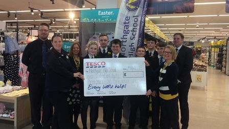 Representatives from Tesco with Mr Mason, Miss Titchen and Mrs Beasley, alongside Northgate High Sch