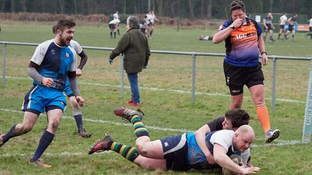 This picture shows club debutant Terry Baker scoring for Fakenham Rugby Club. The club is introducin