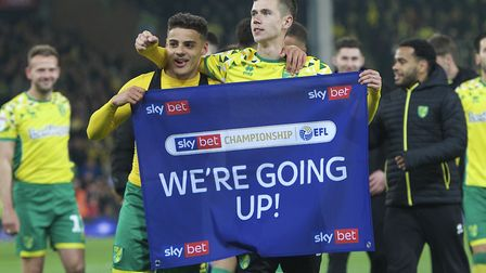 Max Aarons of Norwich City (left) and Todd Cantwell of Norwich City celebrate after winning promotio
