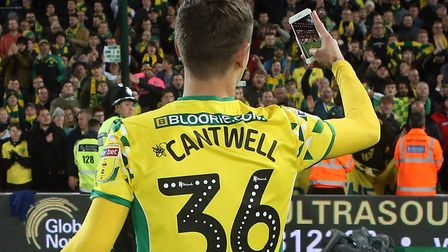Todd Cantwell of Norwich celebrates promotion at the end of the Sky Bet Championship match at Carrow