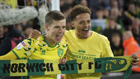 Todd Cantwell of Norwich City and Jamal Lewis of Norwich City (right) celebrate after winning promot