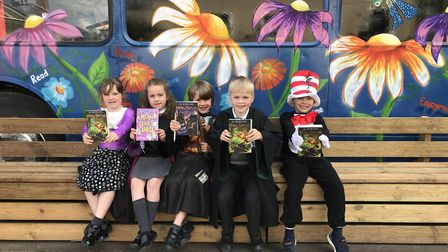 Lilly, Alice, Freddie, Billy and Issac from Mattishall Primary, with their library books from the bu