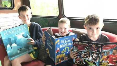 William, Lucas and Harry from Mattishall Primary, enjoying their new library bus. Picture: Ella Wilk