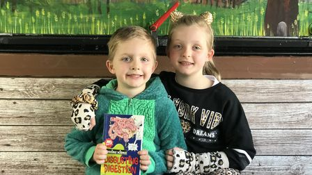 Ollie and Jessica from Mattishall Primary School, enjoying the new library bus. Picture: Ella Wilkin
