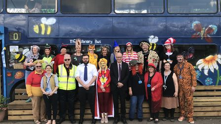 The teaching staff at Mattishall primary school with the representitives from Konect Bus, who donate