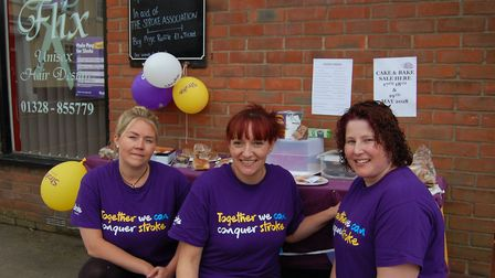 Emma Beaumont, left, with colleagues from Flix Hair Design in Fakenham, fundraising for the Stroke A
