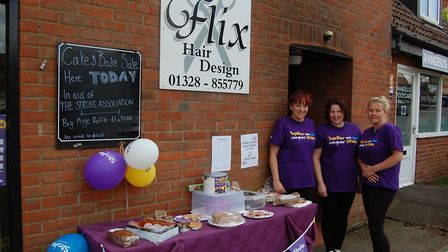 Emma Beaumont, centre, with colleagues from Flix Hair Design in Fakenham, fundraising for the Stroke