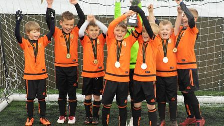 Bawdeswell Youth F.C under 8s team winning the Kappa Cup. Picture: JAMIE SNELL