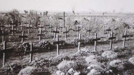 A historic photo of the graveyard of 98 men from the Royal Norfolk Regiment buried in Le Paradis.Pic