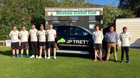 Players from Dereham Cricket Club pose with James Trett from J P Trett, the clubs new shirt sponsor