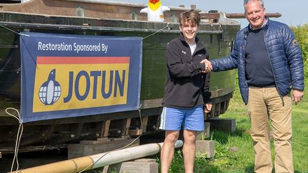 Ash Faire Ring, left, is restoring Growler in Burnham Overy Staithe, with sponsorship from Jotun. He