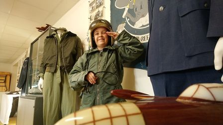 Harry Brown tries out an airman's helmet at RAF Sculthorpe Heritage Centre PICTURE: Ian Brown.