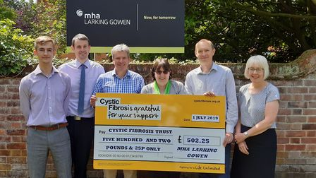 Fundraisers at MHA Larking Gowen in Fakenham with their donation to Cystic Fibrosis Trust PICTURE: S