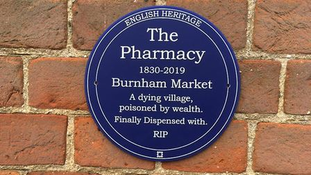 The sign which appeared on the wall of the Pharmacy, Burnham Market, which has closed after being in