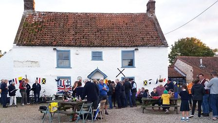 Residents of Burnham Thorpe outside The Lord Nelson pub after it closed. Picture: David Black