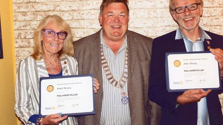 Janet and John Money with Richard Turner (centre) the president of Dereham Rotary Club. Photo: Dereh