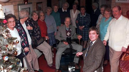 Chairman of Dereham Round Table Richard Turner hands over the mobility scooter to residents at Doris